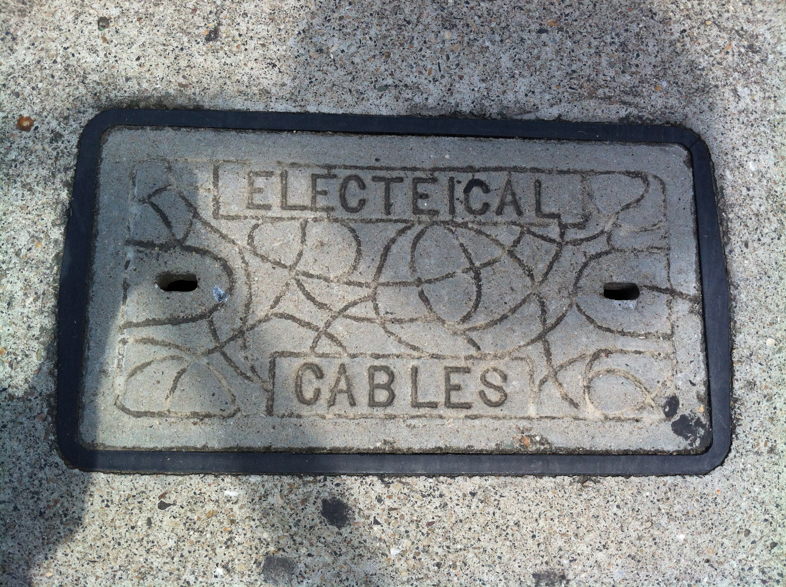 Concrete cover with the typo 'Electeical cables'